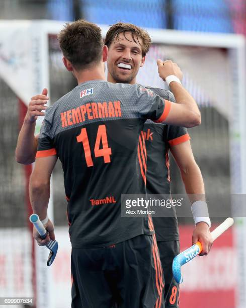Bjorn Kellerman of the Netherlands celebrates scoring his teams fifth goal with teammate Robbert Kemperman during the quarter final match between the...
