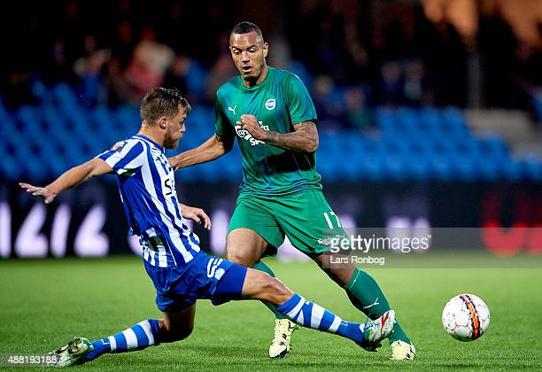 Bjorn Paulsen of Esbjerg fB and Kenneth Zohore of OB Odense compete for the ball during the Danish Alka Superliga match between Esbjerg fB and OB...