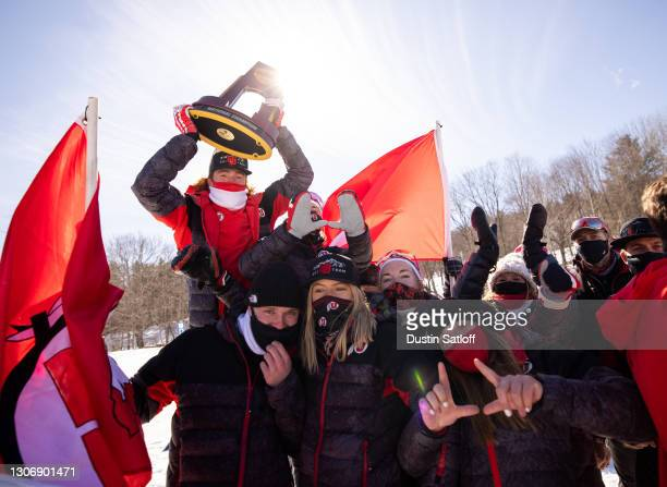 Bjorn Riksaasen of the University of Utah holds up the NCAA Skiing Championship after Utah won the title on March 13, 2021 in Jackson, New Hampshire.
