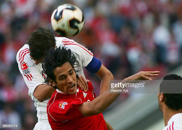 Bjorn Schlicke of Cologne and Roque Santa Cruz of Bayern vie for a header during the Bundesliga match between 1FC Cologne and Bayern Munich at the...