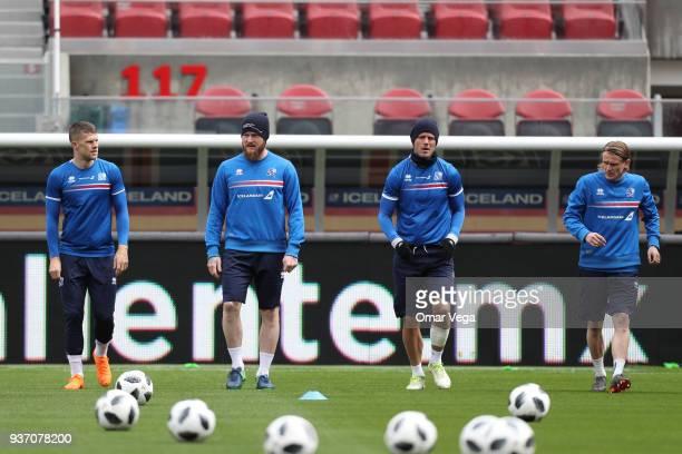 Bjorn Sigurðarson Captain Aron Gunnarsson Alfreð Finnbogason and Ari Skulason warm up during the Iceland training session ahead of the FIFA friendly...