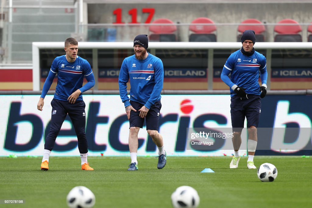 ) Bjorn Sigurðarson, Captain Aron Gunnarsson and Alfreð Finnbogason warm up during the Iceland training session ahead of the FIFA friendly match against Mexico at Levi's Stadium on March 22, 2018 in Santa Clara, California.