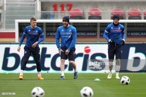 Bjorn Sigurðarson Captain Aron Gunnarsson and Alfreð Finnbogason warm up during the Iceland training session ahead of the FIFA friendly match against...
