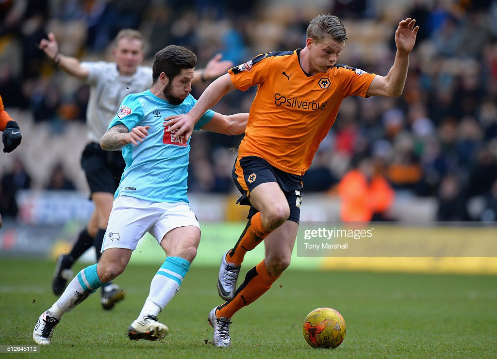 Bjorn Sigurdarson of Wolverhampton Wanderers is tackled by Jacob Butterfield of Derby County during the Sky Bet Championship match between Wolverhampton Wanderers and Derby County at Molineux on February 27, 2016 in Wolverhampton, United Kingdom.