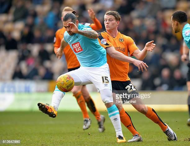 Bjorn Sigurdarson of Wolverhampton Wanderers tackles Bradley Johnson of Derby County during the Sky Bet Championship match between Wolverhampton...