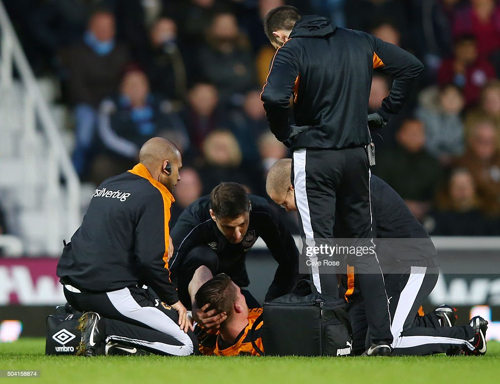 Bjorn Sigurdarson of Wolves receives the medical treatment before being stretched off during the Emirates FA Cup Third Round match between West Ham United and Wolverhampton Wanderers at Boleyn Ground on January 9, 2016 in London, England.