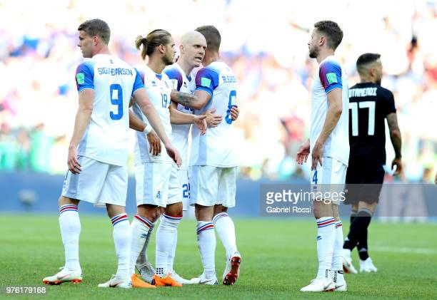 Bjorn Sigurdarson Rurik Gislason Emil Hallfredsson Ragnar Sigurdsson and Kari Arnason of Iceland celebrate following the 2018 FIFA World Cup Russia...