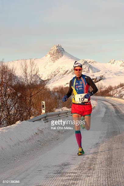 Bjorn Tore Kronen Tananger running the last leg of The Arctic Triple Lofoten X on February 13 2016 in Svolvar Norway The water temperature is around...
