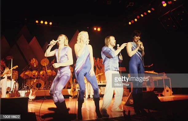 Bjorn Ulvaeus Agnetha Faltskog AnniFrid Lyngstad and Benny Andersson of Swedish pop group Abba perform on stage at Wembley Arena in London England in...