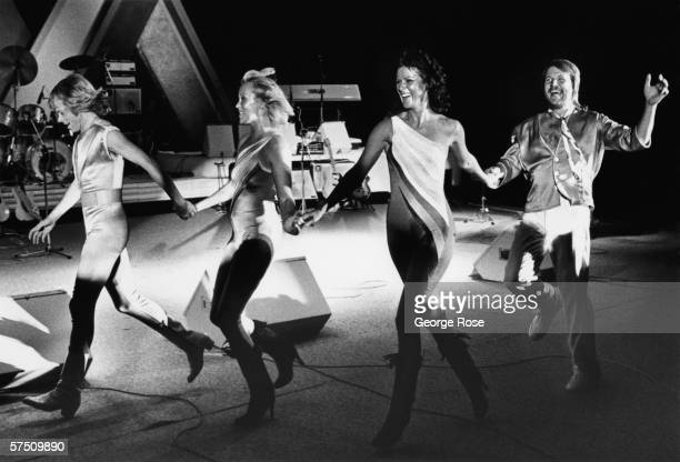 Bjorn Ulvaeus Agnetha Faltskog AnniFrid Lyngstad and Benny Andersson of the pop group ABBA dance across the Concord Pavilion stage during a rare 1981...