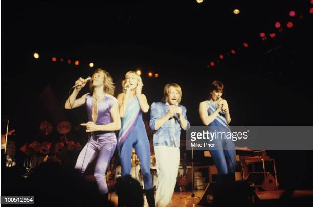 Bjorn Ulvaeus Agnetha Faltskog Benny Andersson and AnniFrid Lyngstad of Swedish pop group Abba perform on stage at Wembley Arena in London England in...