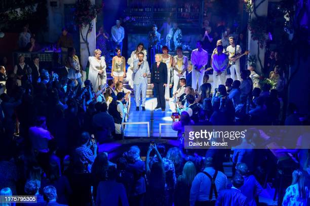 Bjorn Ulvaeus and Ingrid Sutej on stage at the opening night of MAMMA MIA The Party at The O2 on September 19 2019 in London England