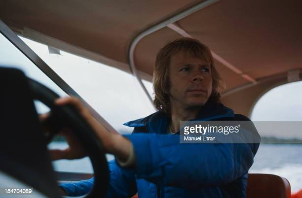 Bjorn Ulvaeus at the helm of a boat