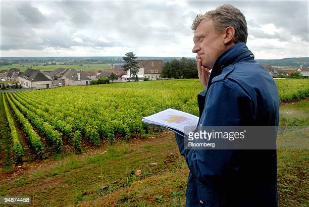 Bjorn von Below, vice president of EFG Bank, uses a local map to locate the Chassagne Clos Saint Jean vines in the Burgundy village of...