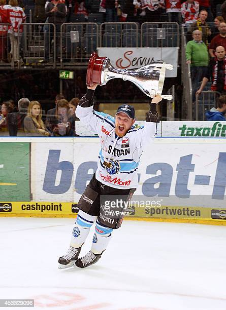Björn Barta holds the trophy after game seven of the DEL playoff final on April 29, 2014 in Cologne, Germany.