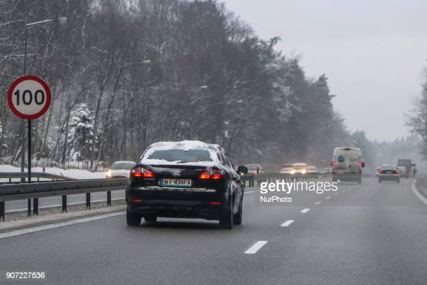 Blacj Ford Mondeo covered by the snow at the Tricity ringroad is seen in Gdansk Poland on 19 January 2018 Heavy snow fall and wind Power has been cut...