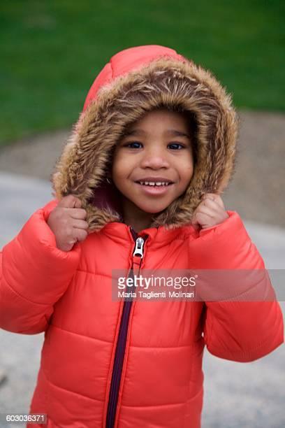 Black 3 year old girl in red fur hood coat