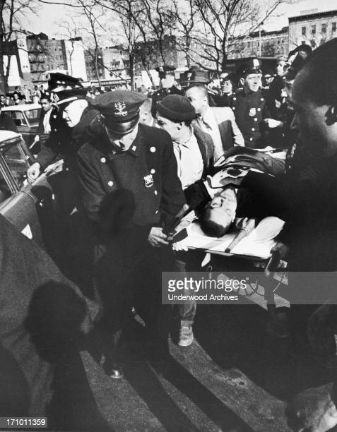 Black activist Malcolm X is carried from the Audubon Ballroom where he had just been shot He died shortly after New York New York February 21 1965