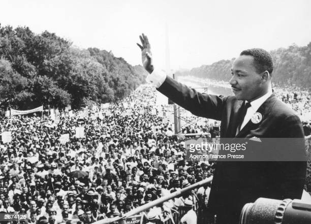 Black American civil rights leader Martin Luther King addresses crowds during the March On Washington at the Lincoln Memorial Washington DC where he...