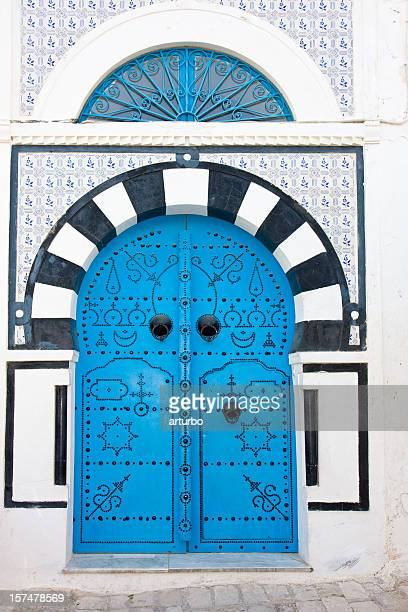 black and blue mediterranean house entrance - tunisia stock pictures, royalty-free photos & images