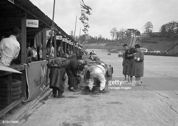 Black and CW Fiennes' MG C type in the pits at the JCC Double Twelve race, Brooklands, May 1931. MG C 746 cc. Event Entry No: 62 Driver: Black, N.,...