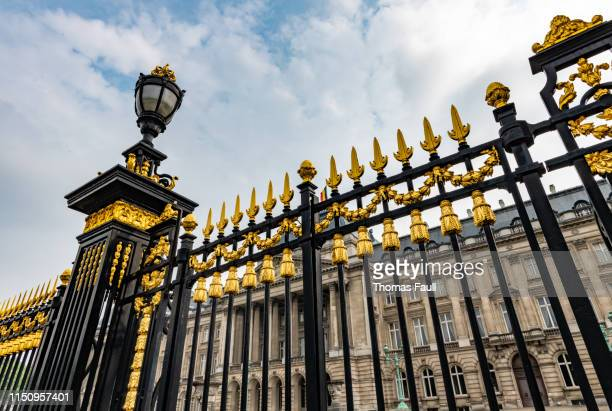 black and gold gates at the royal palace of brussels. - palace stock pictures, royalty-free photos & images