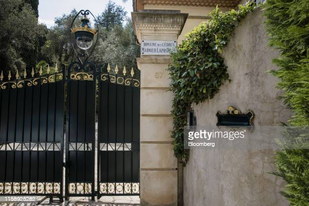 Black and gold painted iron gates stand at the entrance to the Villa Les Cedres a 187yearold000squarefoot 14bedroom mansion set on 35 acres in...