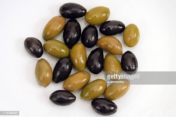 black and green olives from above - kalamata olive stock photos and pictures