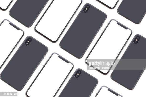 black and pink smartphones close to each other in half turn on white background - modello dimostrativo foto e immagini stock