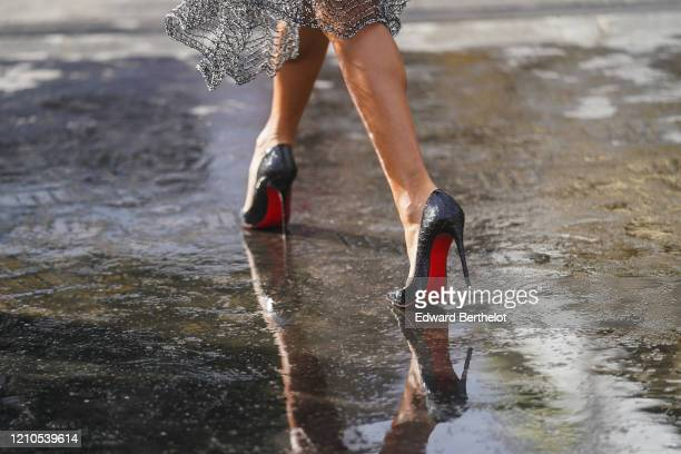 Black and red Louboutin high heel shoes are seen outside Chanel during Paris Fashion Week Womenswear Fall/Winter 2020/2021 on March 03 2020 in Paris...