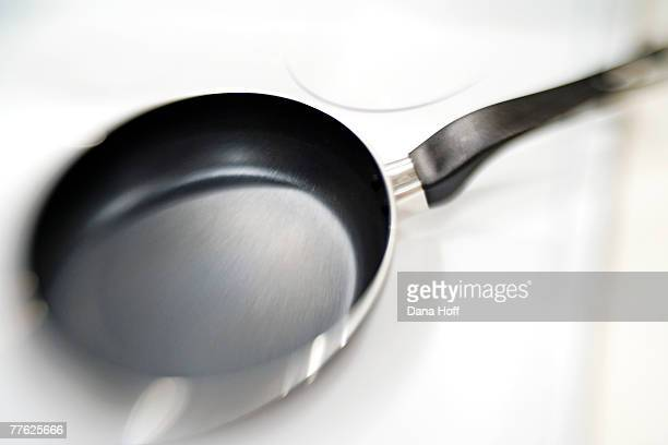 black and silver nonstick pan on white range - dana white stock pictures, royalty-free photos & images