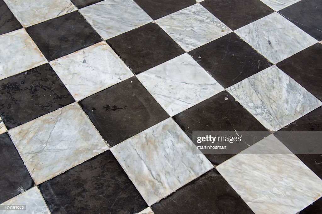 Black And White Checkered Floor Tiles Seamlessly As A Pattern Stock