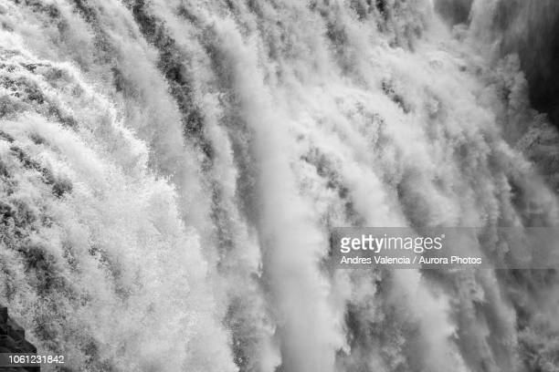 black and white closeup of dettifoss waterfall in iceland. - waterfall stock pictures, royalty-free photos & images