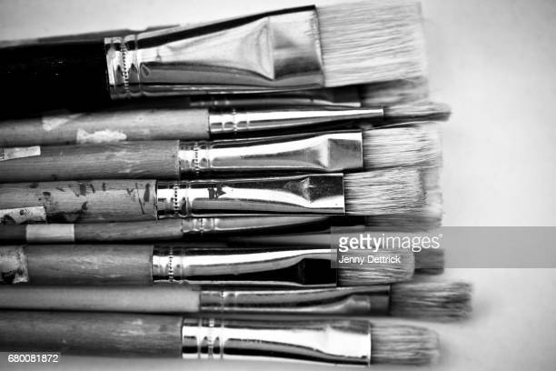 Black and white close-up of paintbrushes