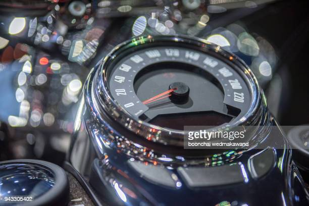 Black and white color with dial miles of motorcycle.