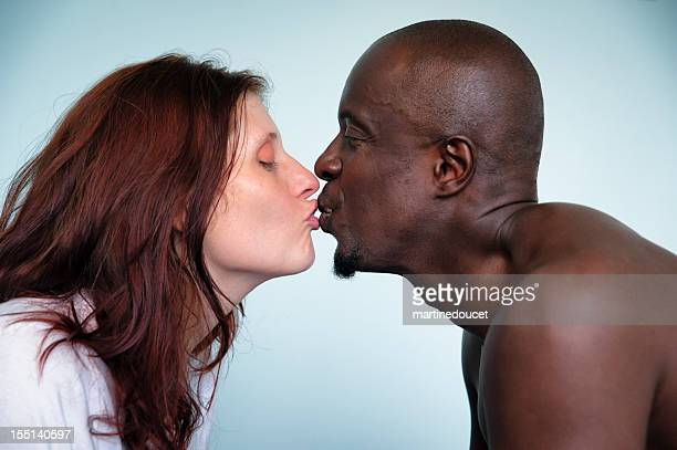 black and white couple. - black women kissing white men stock pictures, royalty-free photos & images