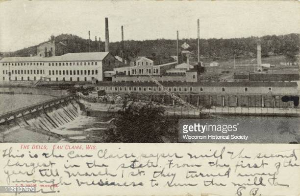 Black and white elevated view of the Dells Pulp and Paper Mill on the Eau Claire River Eau Claire Wisconsin 1900