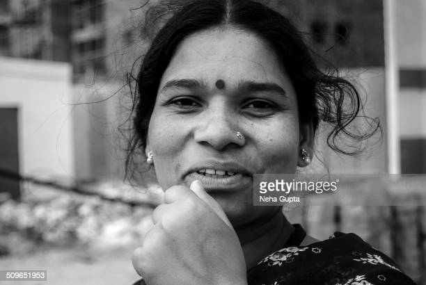 Black and white face shot of an Indian lady.