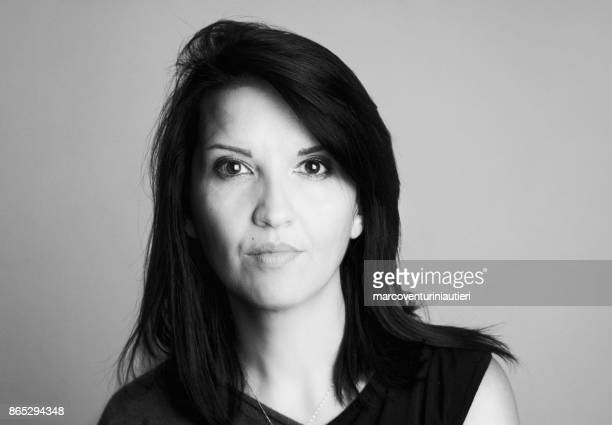 Black and white headshot of caucasian woman