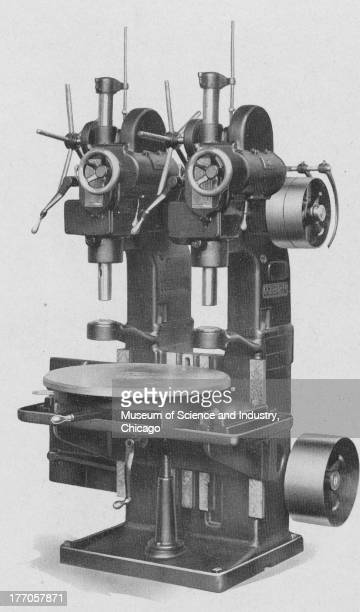 A black and white illustration showing an image of a Colburn Number 2 twospindle manufacturing drill press with a three station indexing table 1929