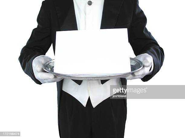 Black and white image of a butler holding a blank paper