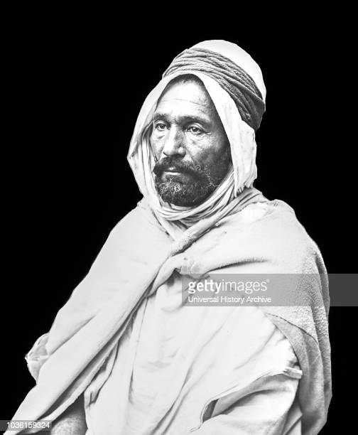 Black and white image of an Arab man against a black background Algiers Algeria