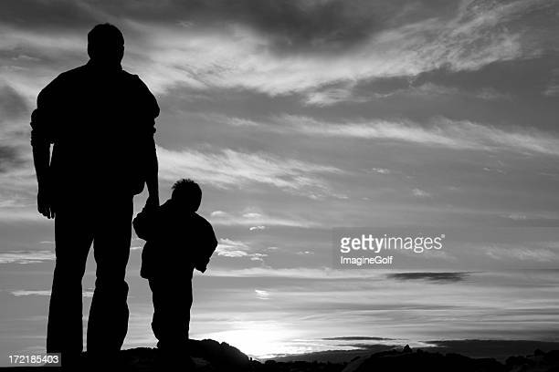 Black and White Image of Father and Son Holding Hands