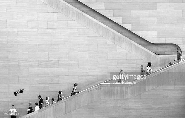 Black and white image of the atrium staircase at the National Gallery of Art's East Building.
