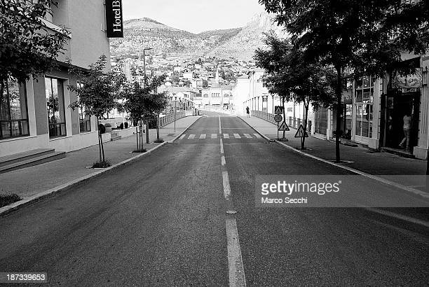 A black and white image of the way leading to Tito Bridge with the Bristol Hotel on the left on June 26 2013 in Mostar Bosnia and Herzegovina The...
