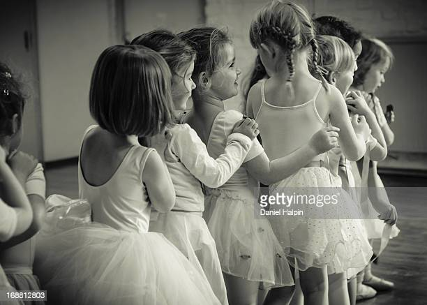 Black and white image of young girls ballet class.