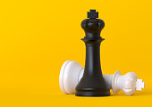 Black and white king chess piece isolated on pastel yellow background