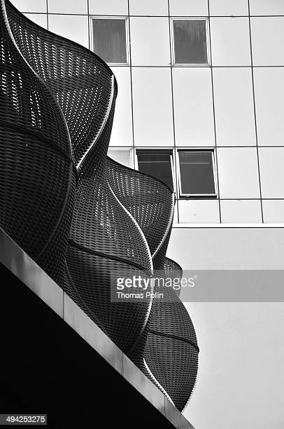 CONTENT] Black and white modern architecture with curves on Guy's and St Thomas' NHS Foundation Trust building at Great Maze Pond Street
