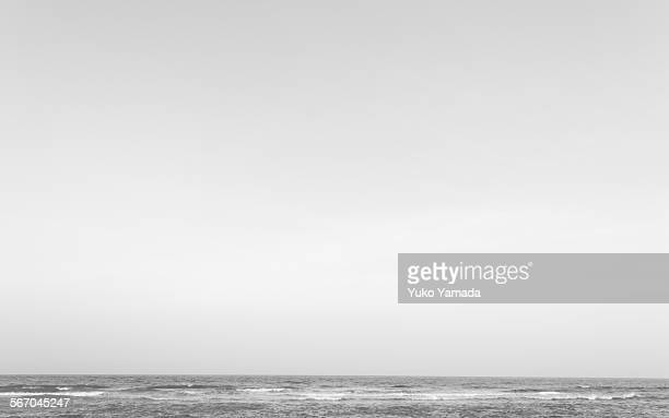 Black and white moody morning sky and sea waves