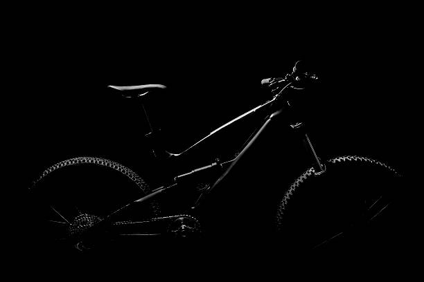 Black and white mountain bike in studio